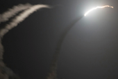 Gold up on Syria bombing, weaker dollar