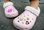 Post Malone, Balenciaga, and teens: Here's what's behind Crocs' huge run over the past year (CROX)