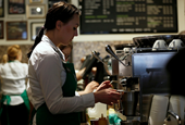 Some Starbucks baristas are begging their former CEO not to run for president (SBUX)
