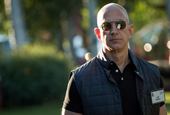 The looming threat from supercorporations like Amazon is helping spur a new wave of megadeals (AVGO,