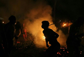 Fire, tobacco and spirits: Venezuelans honor Covid victims with rituals