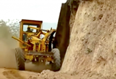 VIDEO: Graders go wheels up to tackle extreme sloping