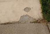How to patch a driveway after the coating has cracked off