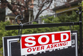 Mounting debt 'worrying' as Canadians stretch to chase rising home prices, says Bank of Canada gover