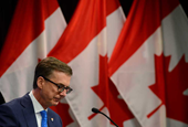Bank of Canada hikes economic forecast, opening door to rate hike in 2022