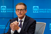 Bank of Canada moves up rate hike forecast, ends QE amid higher inflation