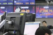Asian stocks weaken on stimulus worries, dollar holds firm