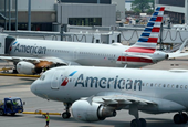 American Airlines turns small profit with taxpayers' help