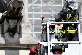 The Latest: Fire chaplain hailed as hero in Notre Dame blaze