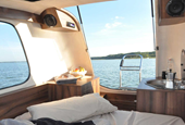 This tiny camper that turns into a boat is coolest summer travel vehicle