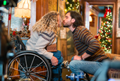 The Star of Lifetime's New Christmas Movie on Filming a Kiss Scene Through Plexiglass