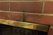 How to clean the bricks above a fireplace