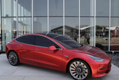 Tesla Inc posts narrower quarterly loss but says Model 3 sedan still on track, shares stay flat
